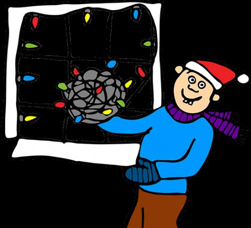Boy hanging Christmas lights window